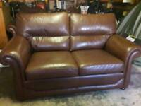 Leather 3 Piece. 2 seater sofa and 2 arm chairs.