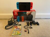 Nintendo Switch 32GB - With Mario kart 8 Deluxe & Super Mario Bros. U Deluxe