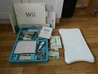 Wii plus two controllers, Wii fit board and game and Wii sports game with box