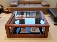 Stylish Solid Wood Square Coffee Table with Smokey Tinted Glass from Distinction