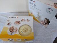 Medela Swing Electric Breast Pump with Calma plus breast milk storage bags by Lasinoh
