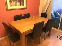 Oak table and 6 chairs for sale