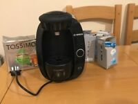 Tassimo T20 bosh coffee and beverage maker with capsules.