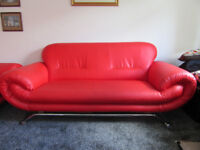 3 seater and 2 seater red leather sofas