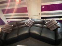 Black 4 seat corner sofa