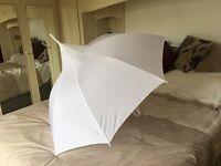 2 large white wedding umbrellas