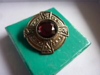 Lovely old collectible vintage brooch badge with red stone