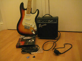 Stratocaster electric guitar and Fender Squier amplifier package