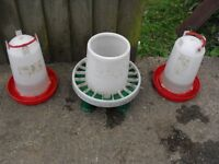 Chicken feeder and water tubs.