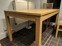 Extendable dining table and set of 4 chairs