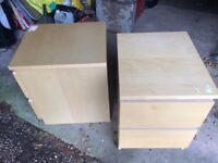 A pair of Natural pine coloured bedside tables.