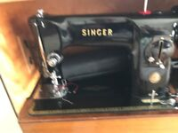 Singer sewing machine and case,in good working order sews leather and denim