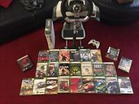 MUST SEE!! Xbox 360 with racing wheel and 26 games