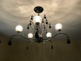 A pair of chandeliers. VGC