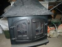 large wood burner ,good condition alround with chimmney pipe