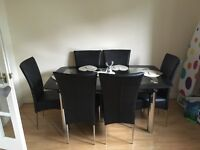 Black Glass Dining Table and 6 chairs. 2 years old mint condition.