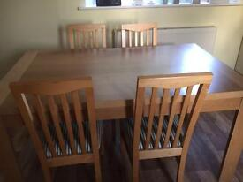 5ft wooden table and 6 chairs