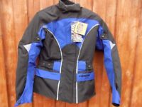 woman's motorcycle jacket lady's large, new and unused.