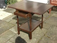 Solid Wood Trolley Table with many usefull features.