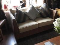 Two seater rattan/cushion sofa
