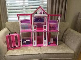 Barbie dream house and air plan sold as seen