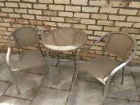 Rattan style table and 2 chairs,