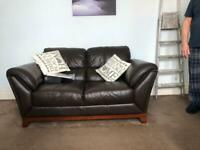 2 x brown leather couches