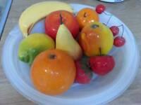 Glass bowl with ceramic fruit