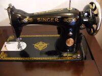 Vintage 1937 Singer 15K80 sewing machine in cabinet