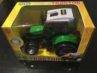Toy friction powered green Tractor Brand new in box