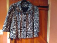 Animal print short jacket. Good condition