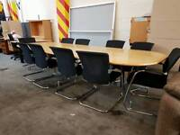 Large boardroom table with 10 chairs