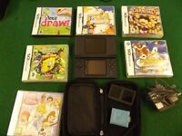 Nintendo DS in black with case, 6 games and charger. All in good condition.