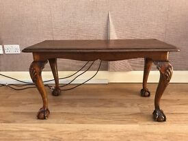 Reproduction antique coffee table with ball and claw feet