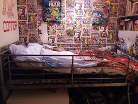 Metal framed mid sleeper single bed