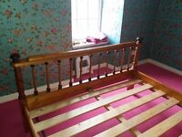 King size wooden bed with lovely decorative detail