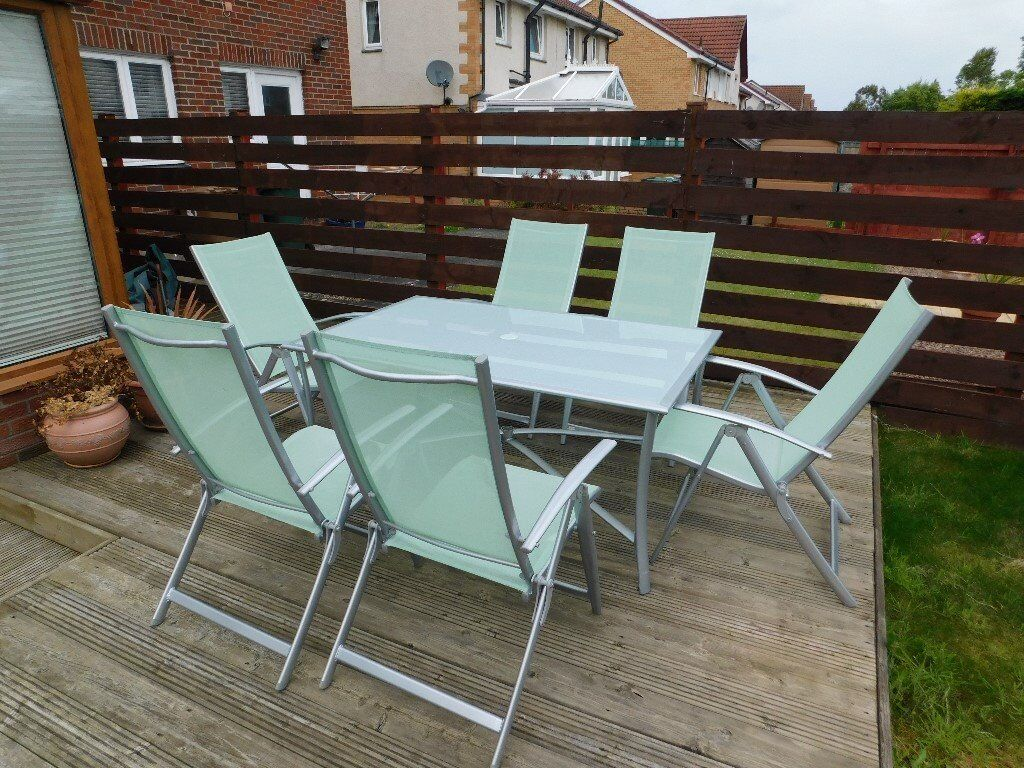 Gorgeous Outdoor Dining Table And Fully Adjustable Chairs In - Adjustable outdoor dining table