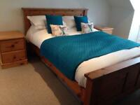 King size bed with mattress and bedside tables