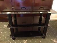 Solid Black Glass TV Stand.