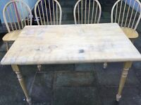 Pine table and four chairs. Table top needs a rub down but otherwise good condition. Buyer collects