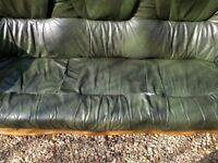 Leather sofa, 3 seater, wood frame and handy draws. Tear in leather