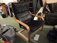 Black leather bentwood IKEA Poang chair. Attractive, stylish and very comfortable