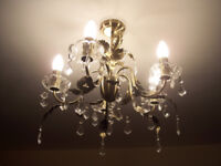 Chandelier, in brushed antique bronze with crystal drops