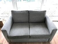 Perfect condition, grey two seater fabric sofa!