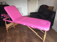 Hot pink massage table