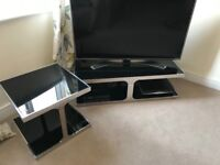 Black glass tv stand and matching table