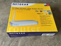 NETGEAR 54 Mbps Wireless ADSL Modem Router with 4-port 10/100 Mbps switch DG834G