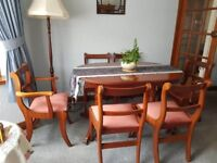 Cherry wood dining room table Extendable with 6 chairs