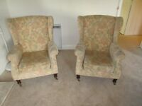A matching pair of Parker Knoll wing-back armchairs in floral pattern velour