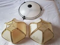 2 Plastic lampshades, colour gold